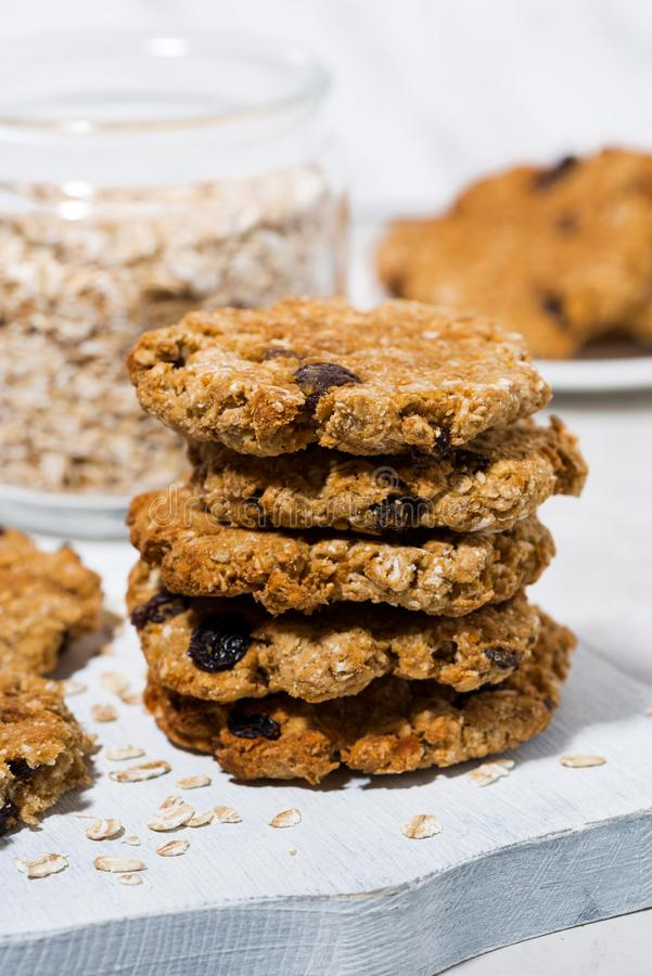 homemade oatmeal cookies with raisins on wooden board, vertical royalty free stock photos