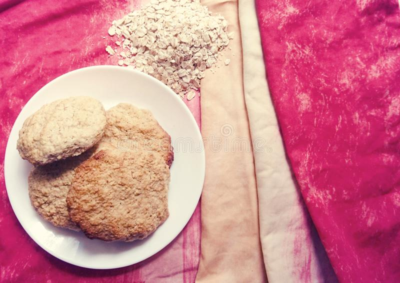 Homemade oatmeal cookies on a white plate. stock photos