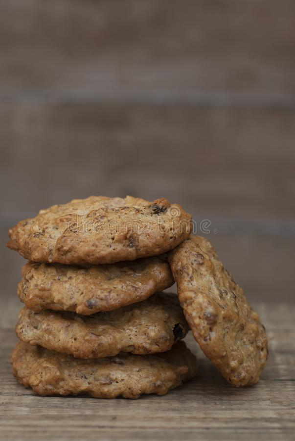 Homemade oatmeal cookies on wooden rustic board. Sweet dessert snack, Healthy Food. Copy space. stock photos