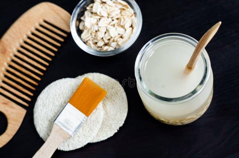 Homemade oatmeal face cleanser. DIY oatmeal milk or toner for natural skin care. Homemade oatmeal face cleanser. DIY oatmeal milk and toner for natural skin stock photos