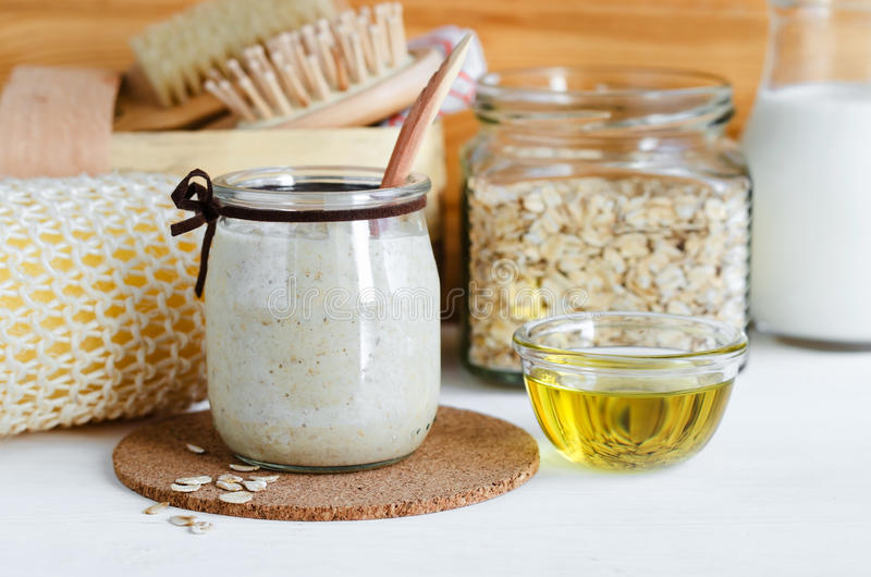 Homemade oatmeal mask in a glass jar. Gentle scrub for sensitive skin. Diy cosmetics royalty free stock images