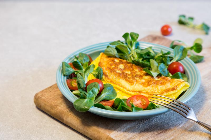 Homemade omelette with salad on plate. Healthy food concept stock photos