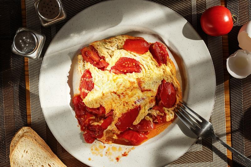 Homemade omelette with tomatoes royalty free stock images
