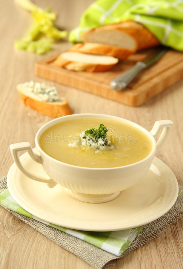 Homemade onion soup with celery and blue cheese stock images
