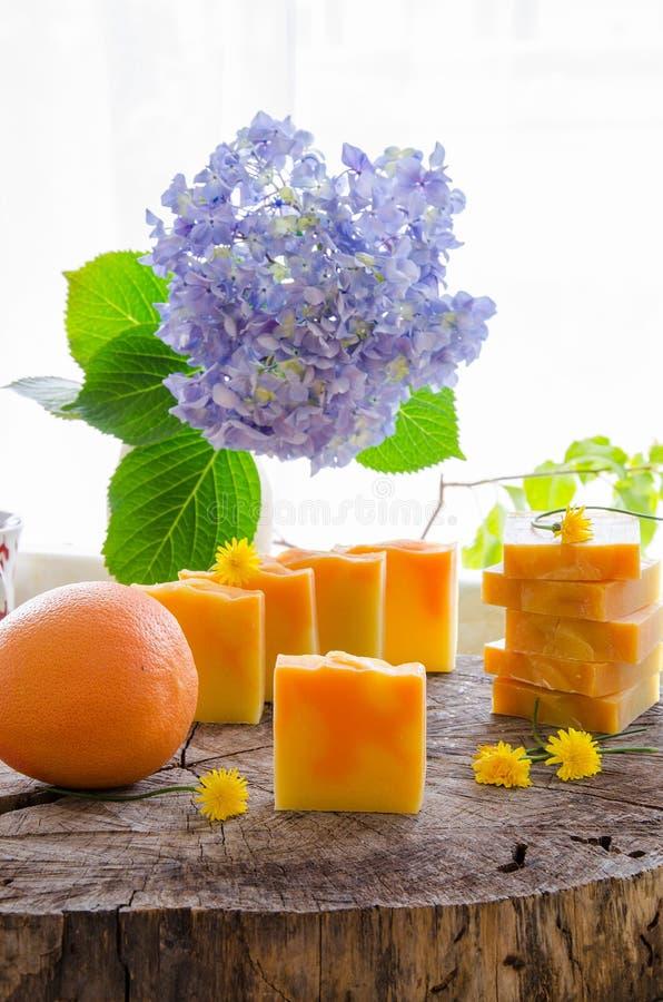 Homemade orange and dandelion herbal soap stock photo