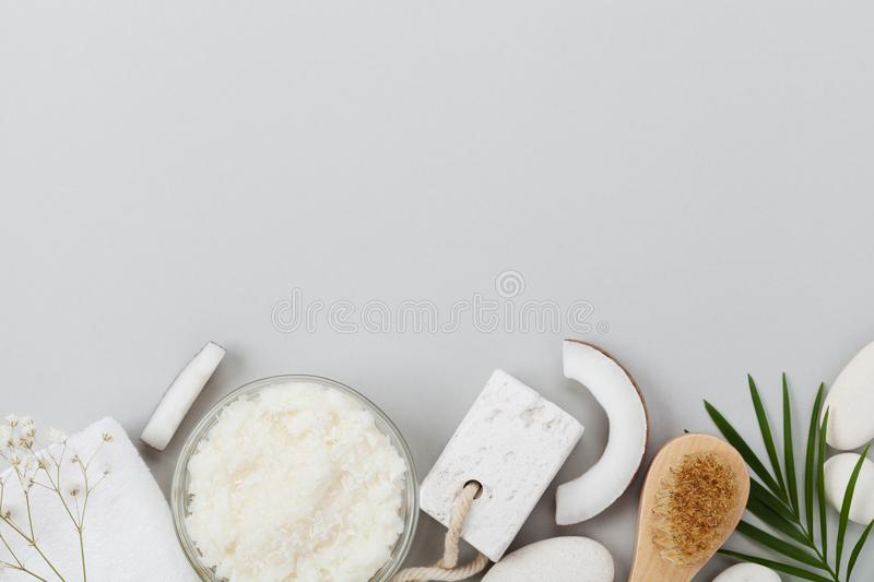 Homemade organic cosmetic for peeling and spa care. Body scrub of coconut oil, sugar and shavings top view. Flat lay. Homemade organic cosmetic for peeling and royalty free stock images