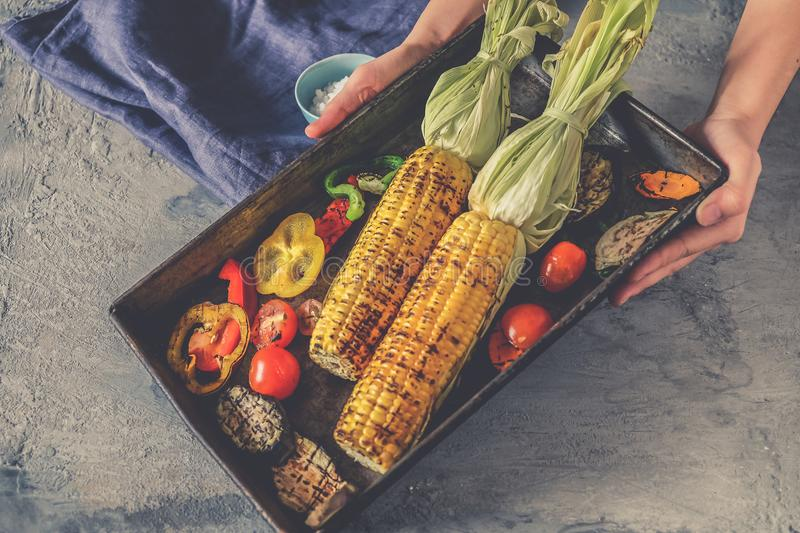 Homemade organic grilled summer vegetables on rustic table. Corn, pepper, onion, eggplant, zucchini. Vegetarian food concept royalty free stock image