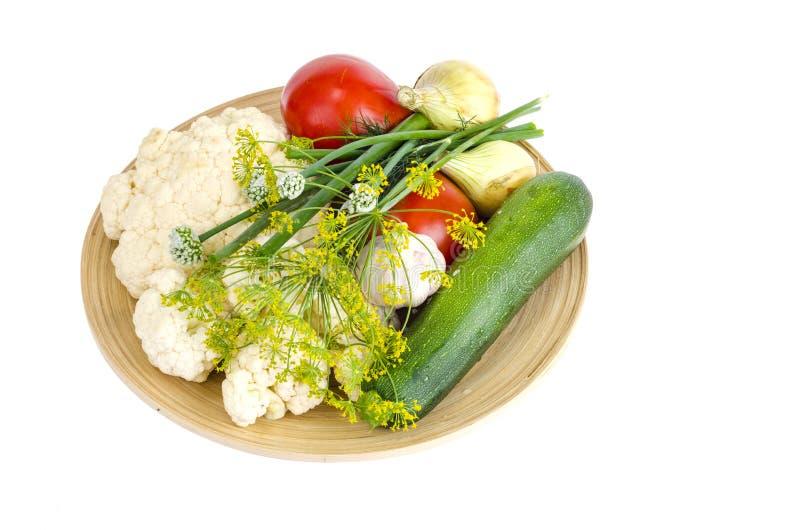 Homemade organic seasonal vegetables on wooden plate. Studio Photo stock image