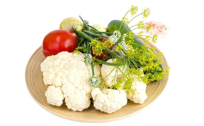 Homemade organic seasonal vegetables on wooden plate. Studio Photo royalty free stock images