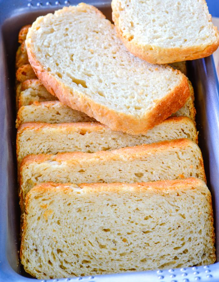 Loaf of bread. Homemade oven fresh wholemeal bread cut into loaves in a bread tin royalty free stock photography