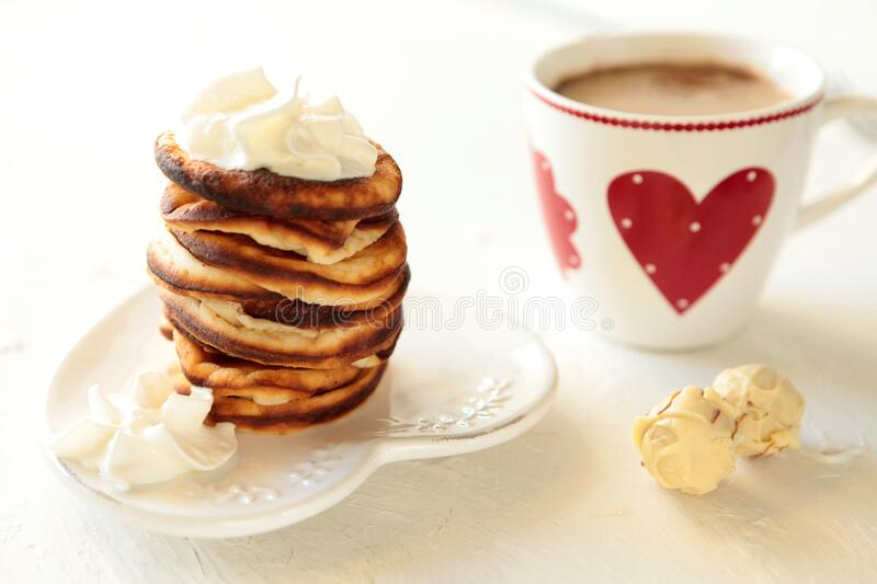Homemade pancakes with breackfast coffee cup. Healthy morning breakfast with candies. food photography. home cooking and baking stock image