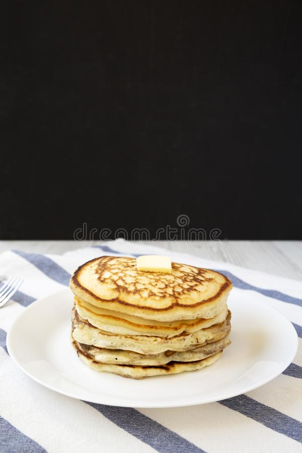 Homemade pancakes with butter on a white plate, low angle view. Closeup.  stock photography
