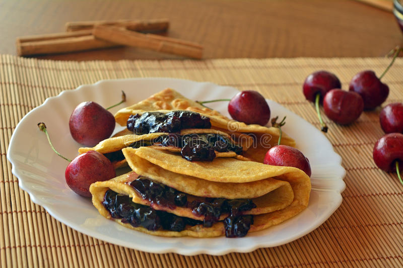 Homemade Pancakes With Jam And Fresh Cherries royalty free stock images