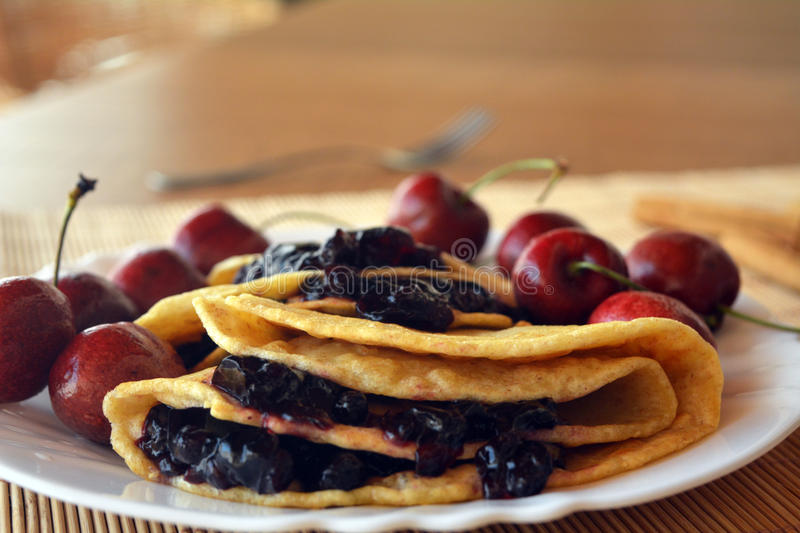 Homemade Pancakes With Jam And Fresh Cherries royalty free stock image