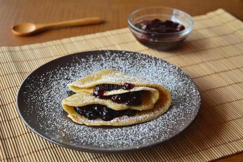 Homemade pancakes with jam and icing sugar. stock photos