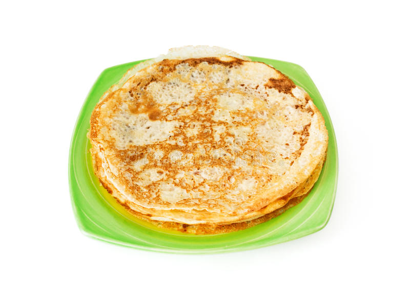 Homemade pancakes pile on plate. Isolated on white background royalty free stock photo