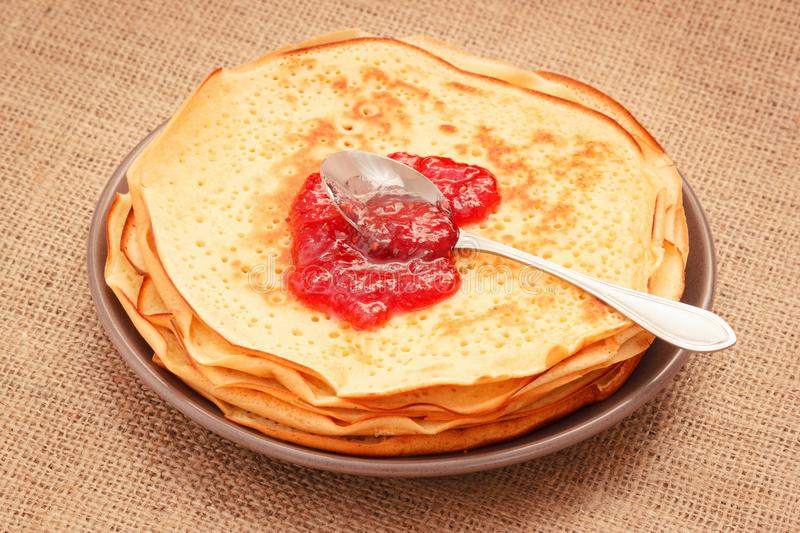 Homemade pancakes with raspberry jam stock images