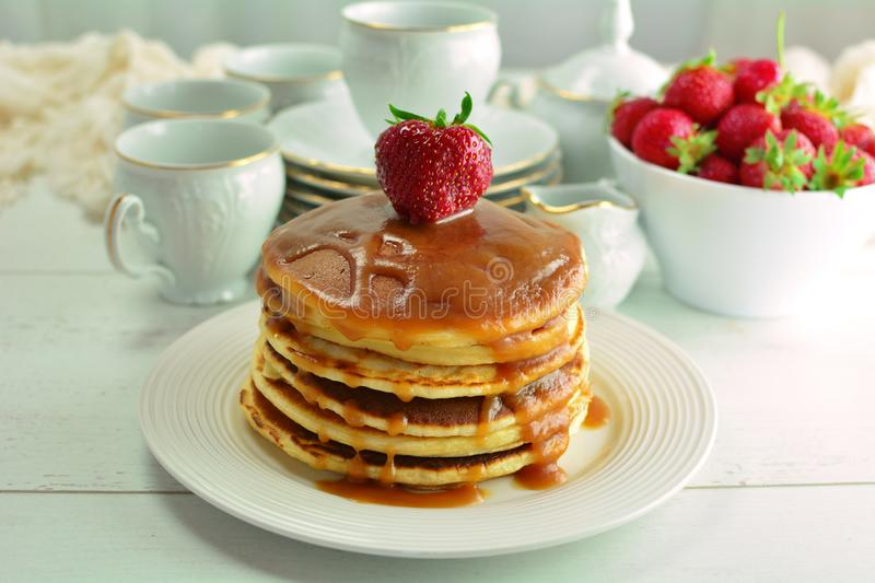 Homemade Pancakes with Salted Caramel Sauce stock images