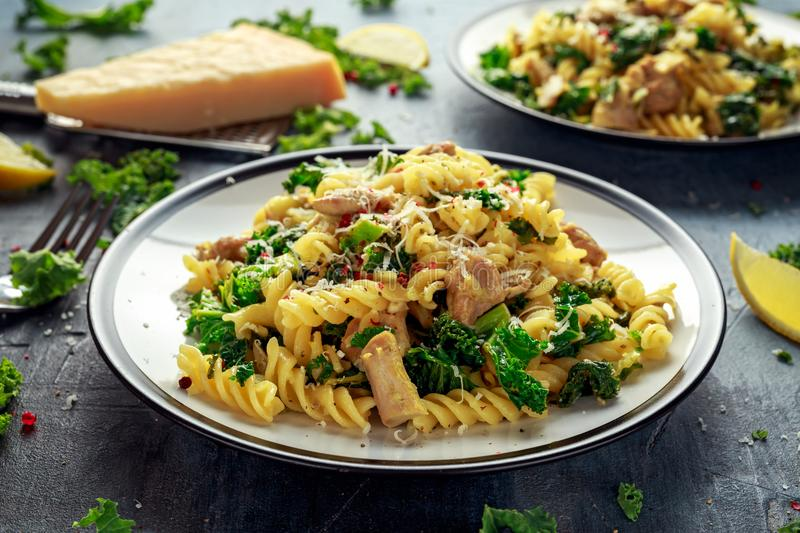 Homemade Pasta fusilli with Chicken, Green Kale, Garlic, lemon and parmesan cheese. healthy home food.  royalty free stock image