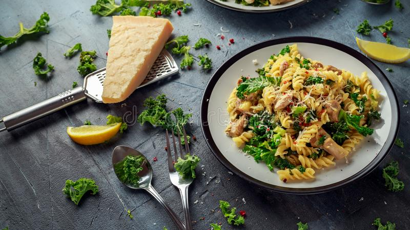 Homemade Pasta fusilli with Chicken, Green Kale, Garlic, lemon and parmesan cheese. healthy home food.  royalty free stock photos