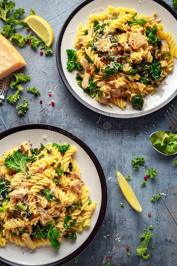 Homemade Pasta fusilli with Chicken, Green Kale, Garlic, lemon and parmesan cheese. healthy home food.  royalty free stock images