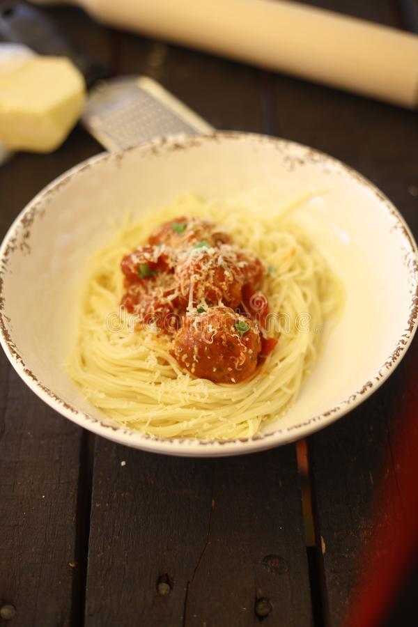 Homemade pasta and meatballs with tomato souse royalty free stock image