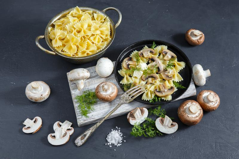 Homemade pasta with mushrooms. Delicious rustic dish, one large portion. Homemade pasta with mushrooms champignon. Delicious rustic dish, one large portion stock image