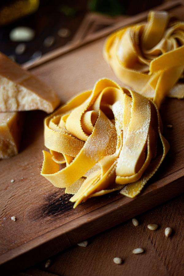 Homemade pasta pappardelle on a cutting board royalty free stock photos
