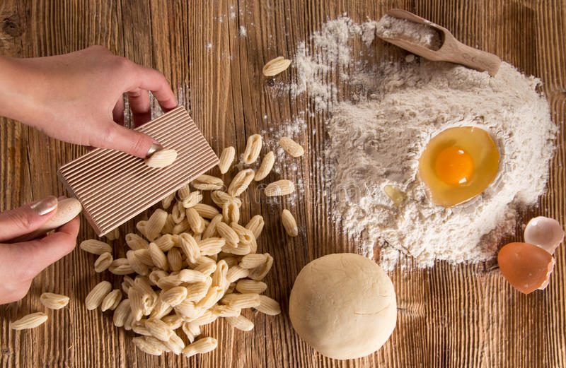 Homemade pasta rigate with egg, flour on a wood table royalty free stock photography