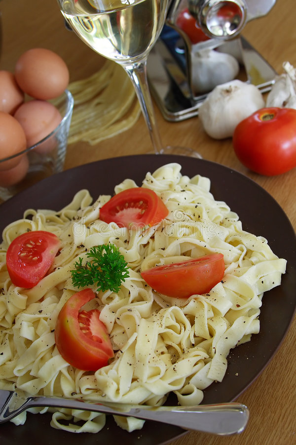 Homemade pasta with wine stock image