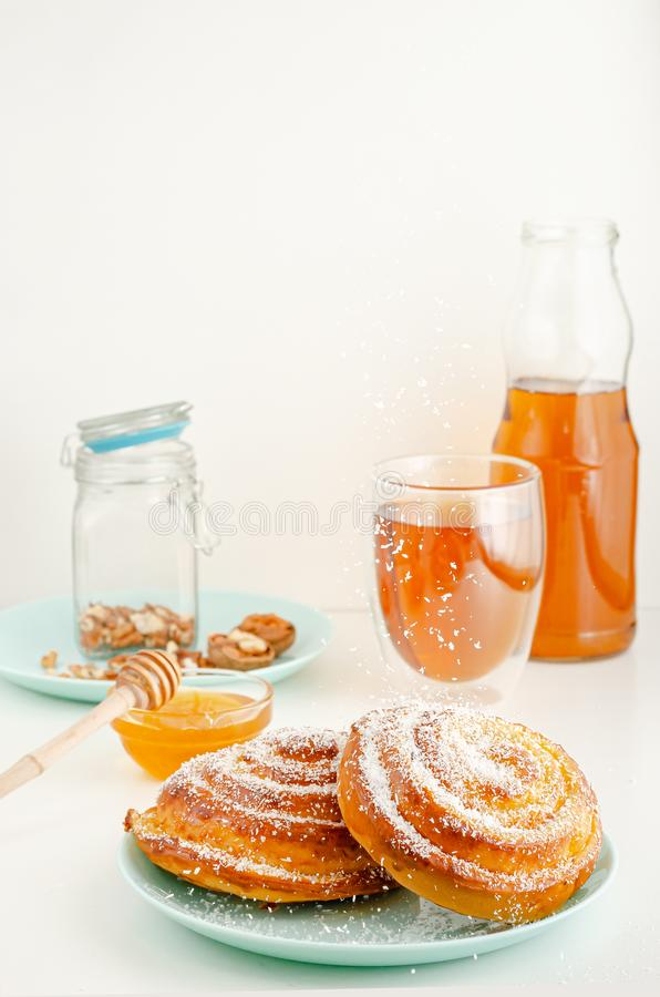 Freshly baked rolled buns with sprinkling grated coconut. Breakfast concept royalty free stock photo