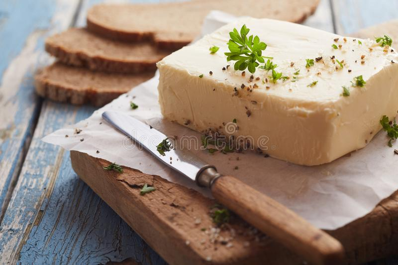 Homemade pat of farm fresh herbed butter royalty free stock images