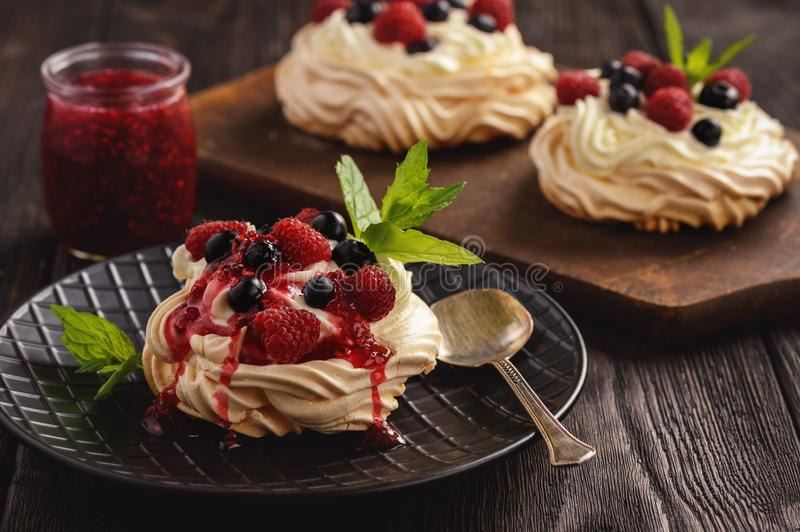 Homemade Pavlova dessert with raspberries and blueberries. stock images