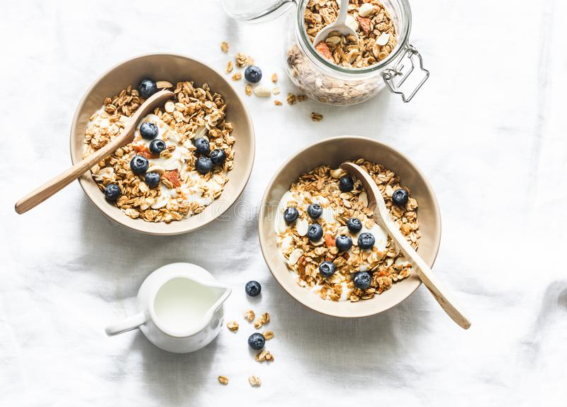 Homemade peanut butter granola with greek yogurt and blueberries on a light background, top view. Healthy energy breakfast or snac. K. Flat lay royalty free stock images