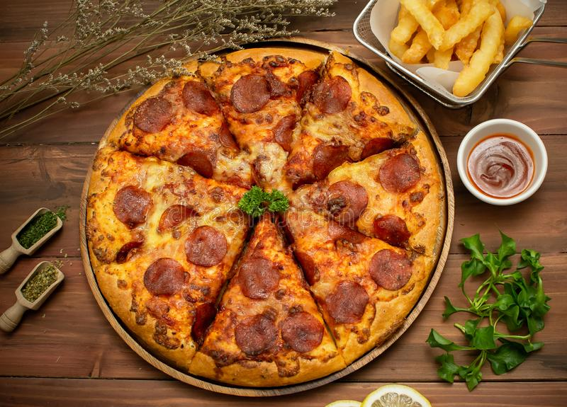 Homemade pepporoni pizza with the ingredients royalty free stock photos