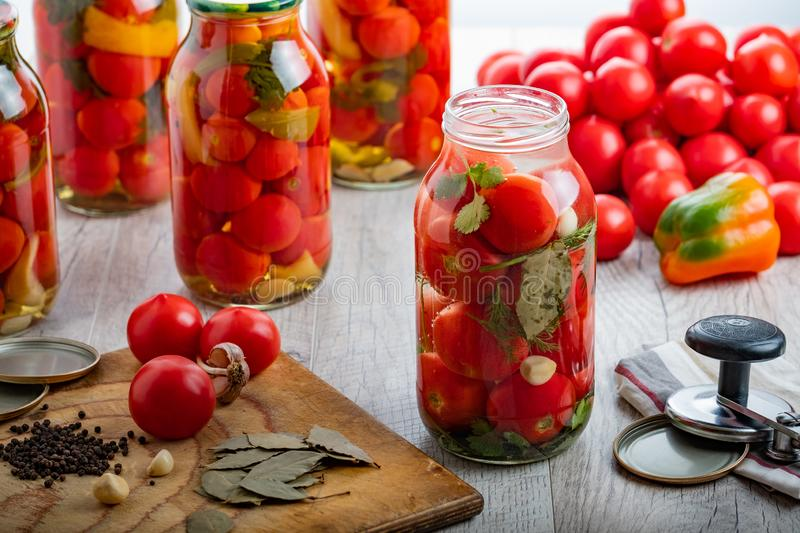 Homemade pickled tomatoes in jar. Selective focus. stock image