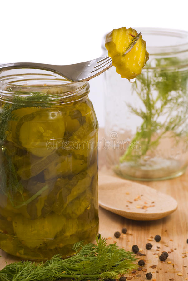 Homemade pickles. Being preserved with dill and peppercorns stock photography
