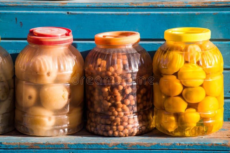 Homemade pickles variety preserving jars stock photo