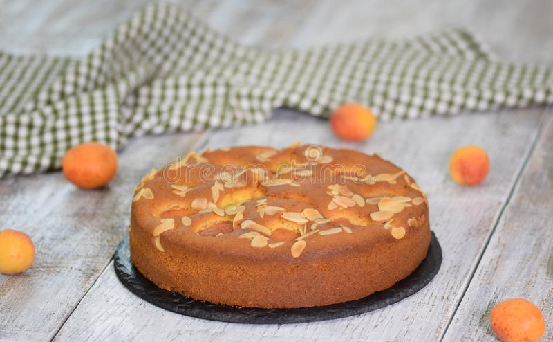 Homemade pie with apricots and almonds on wooden rustic background stock photography