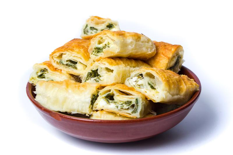 Homemade pie with cheese and spinach isolated. On white stock image