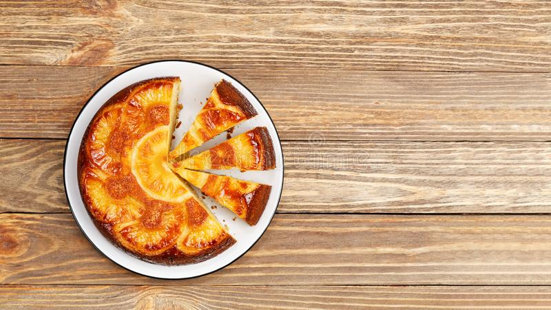 Homemade Pineapple Upside Down Cake on wooden table. Top view. stock photo