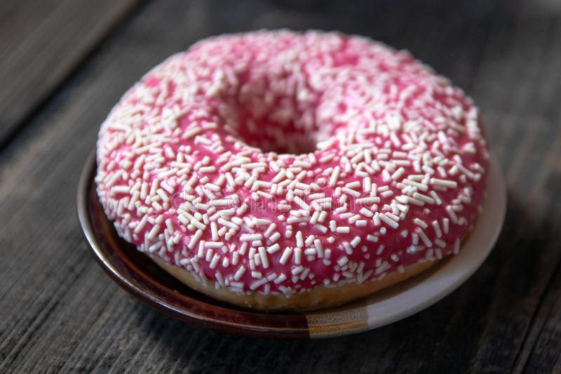 Homemade pink glazed donuts royalty free stock photo