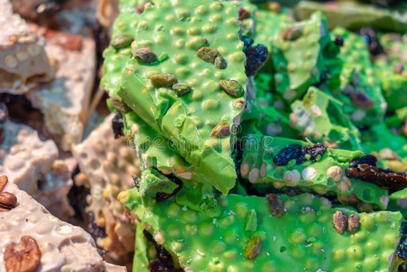 Homemade pistachio green chocolate for sale at Krakow christmas market. Poland royalty free stock photo