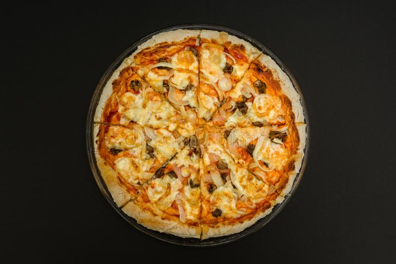 Homemade pizza on a black background royalty free stock photos