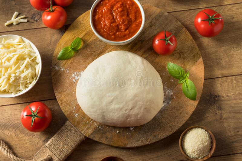 Homemade PIzza Dough and Ingredients royalty free stock images