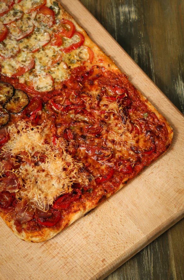 Homemade Pizza Four Tastes royalty free stock images