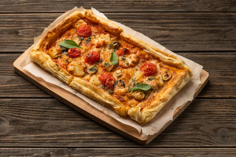 Homemade pizza with pineapple and shrimps royalty free stock image