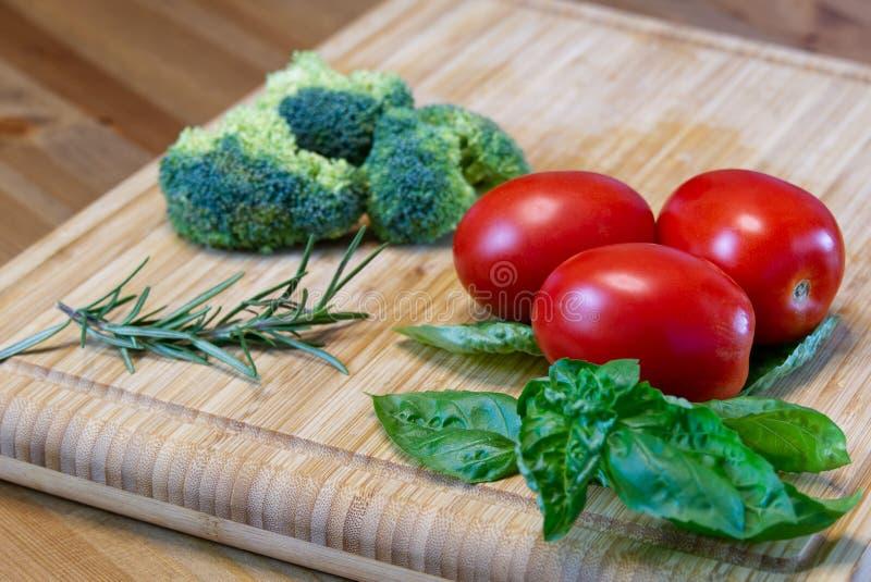 Homemade pizza sauce ingredients. tomato, basil, broccoli, olive oil, onion, garlic. rosemary royalty free stock photos