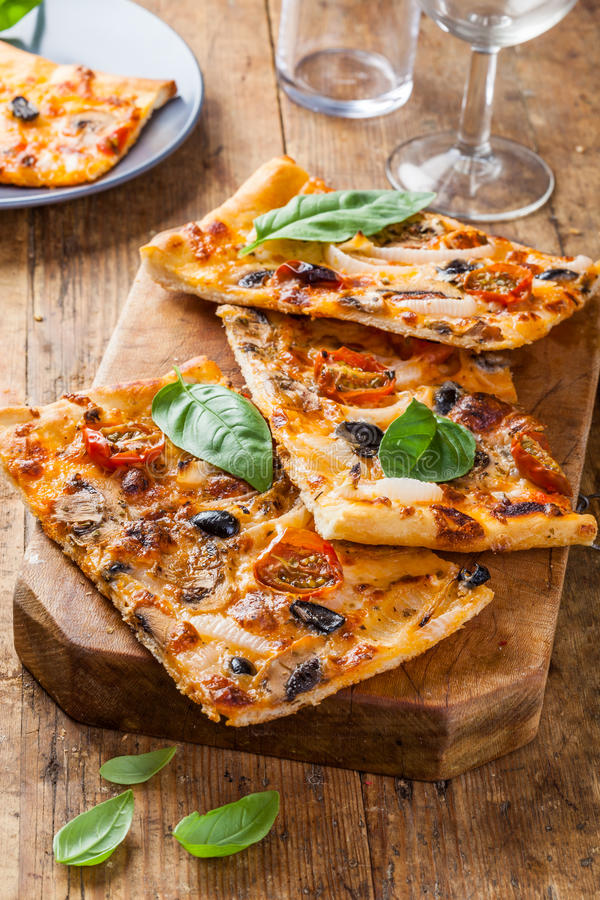 Homemade pizza slices royalty free stock image