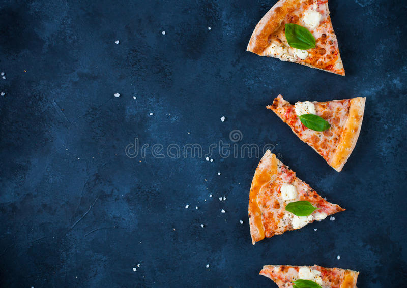 Homemade pizza with tomatoes, mozzarella and basil. Top view on royalty free stock images